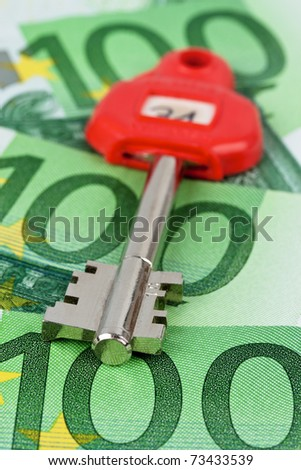Many of euro notes and the key of a safe.