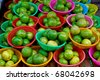 many of fresh limes in basket in fresh market , Asia , Thailand - stock photo