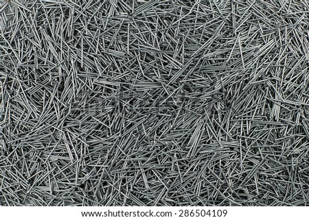 many of metal nails 1 inch small head - stock photo