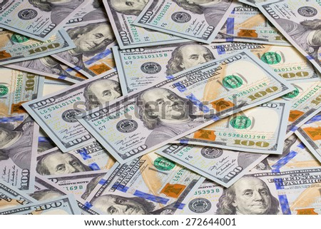 Many of one hundred dollars banknotes background - stock photo
