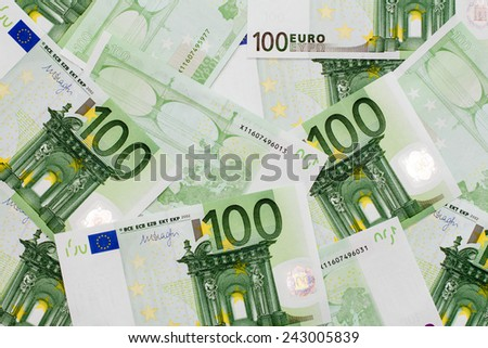 Many of one hundred euro banknotes lie side by side. Concept for wealth and investment