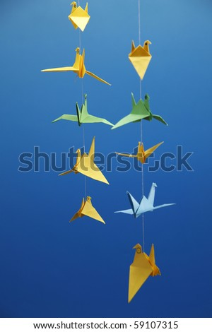 many of origami bird hanging  in a row - stock photo