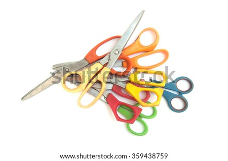 Many of scissors on white background