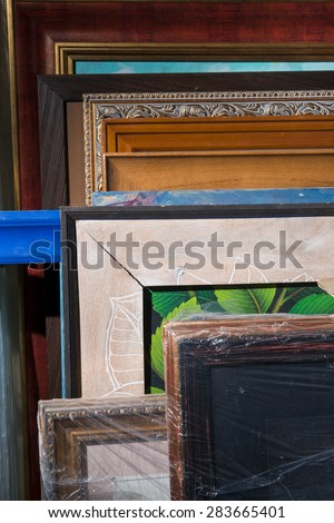 Many of the pictures in the frames in the store - stock photo