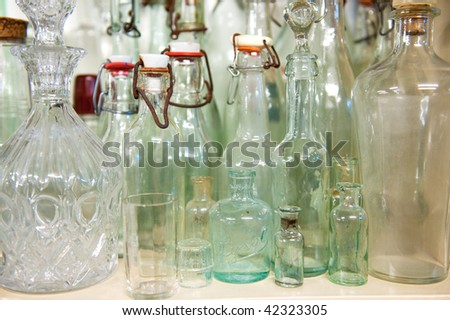 Many old antique vintage glass bottles big and small