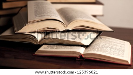 Many old books combined by a heap - stock photo