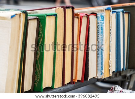 Many old books in a book shop or library - stock photo