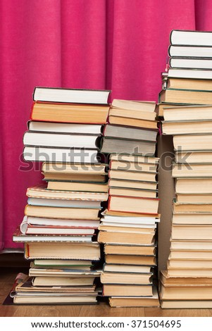 Many old books standing stacks. Education or library concept - stock photo