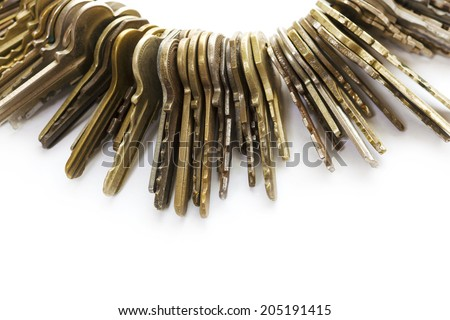 Many old brass keys on white background. Security and encryption, concept image.  - stock photo