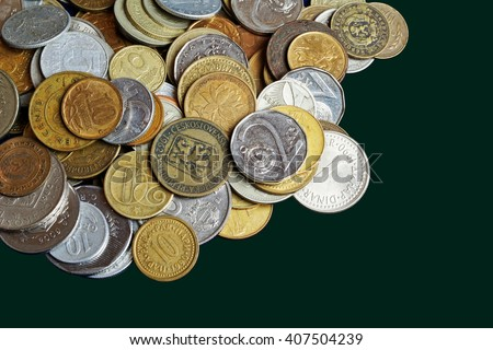 Many old coins isolate on a dark background with free space - stock photo