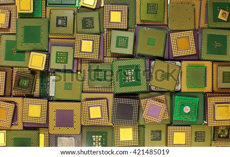 Many old CPU chips and obsolete computer processors as background - stock photo