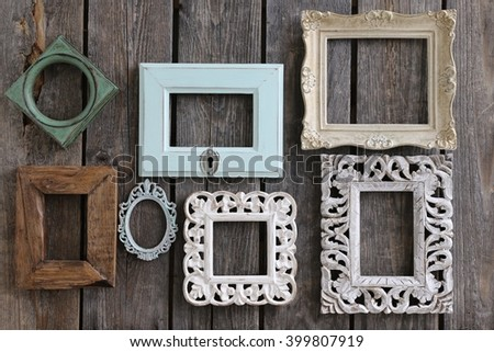 Many old frames of rectangular, square, oval, composition with vintage wooden frames, white, brown, gold, green and blue  - stock photo