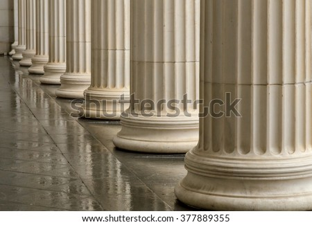 Many old greek columns with reflection - stock photo