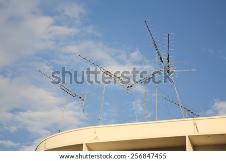 Many Old Home TV antennas mounted on top of building - stock photo