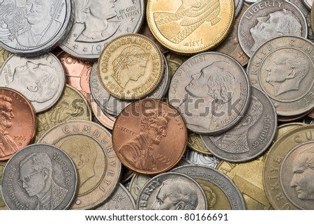 Many old metal coins of different countries of world - stock photo