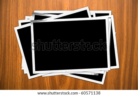 Many old photos on wooden background - stock photo
