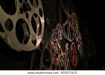 many old roll films in the dark  - stock photo