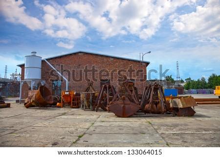 Many old rusty excavators bucket. - stock photo