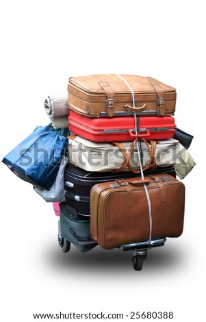 Many old suitcases on a cart - stock photo