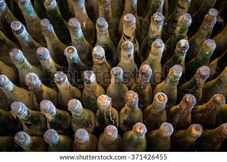Many old wine bottles top view - stock photo