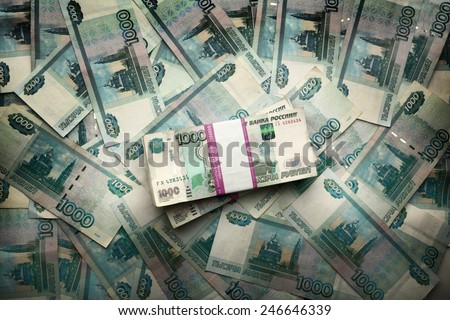 Many one hundred ruble banknotes as background - stock photo