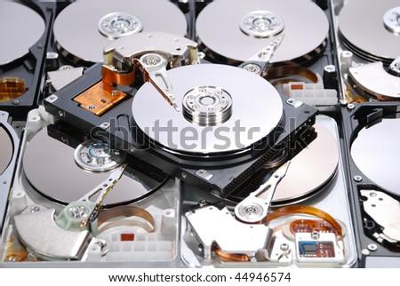 Many Open Hard drives isolated on white background - stock photo