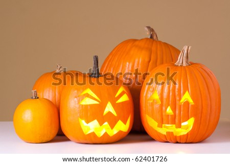 Many orange halloween pumpkins and Jack O Lanterns. - stock photo