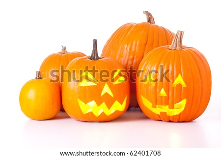 Many orange halloween pumpkins and Jack O Lanterns isolated on white background. - stock photo