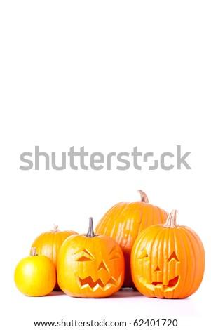 Many orange halloween pumpkins and Jack O Lanterns isolated on white background. - stock photo