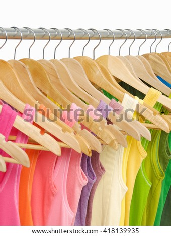 many peignoir and shirt hanging on wooden hangers - stock photo