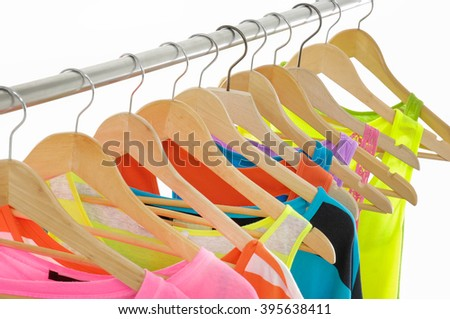 many peignoir hanging on wooden hangers - stock photo