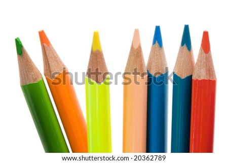 Many pencils of different colors on a over white background-Shallow DOF- - stock photo