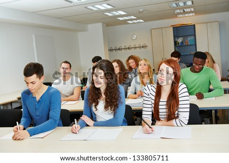 Many people doing further training in a school classroom - stock photo
