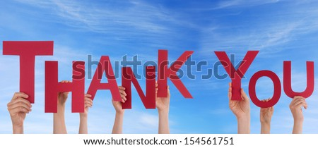 Many People Holding the Word Thank You in the Sky - stock photo