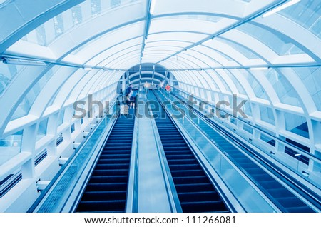 Many people using escalator, blurred motion - stock photo
