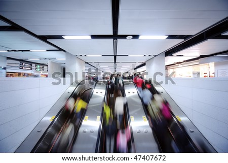 Many people using escalator, blurred motion