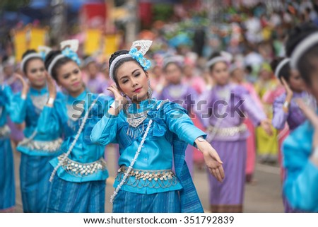 Many people watch beautiful girl dance in candle festival UbonRatchathani, Thailand - stock photo