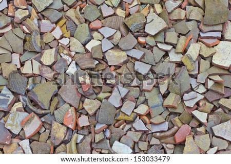 many pieces of broken earthen jars - stock photo