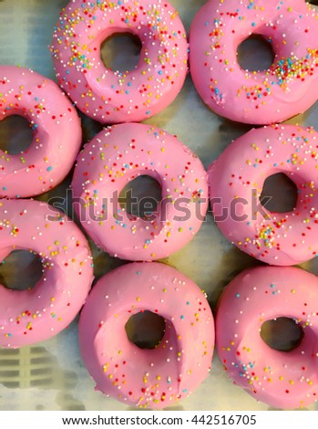 Many pieces of pink candy doughnut  on tray