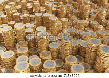 Many piles of one Euro coins - stock photo