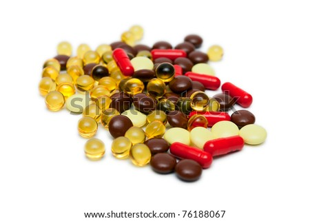Many Pills and capsules isolated on white - stock photo