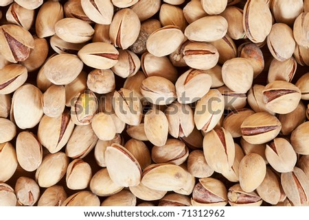 Many pistachios, may be used as background - stock photo