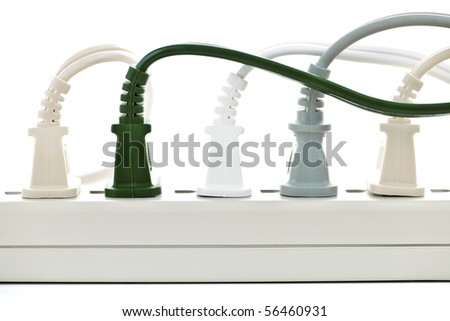 Many plugs plugged into electric power bar - stock photo