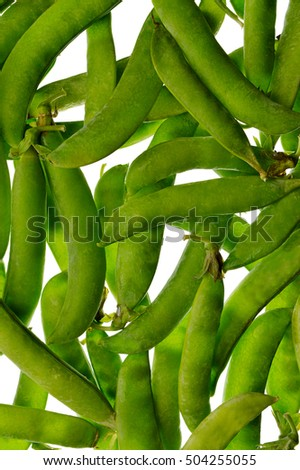 Many pods of green peas, isolation on a white background without shadows. Top view. Food background. Healthy eating. Organic products. Vitamins.Close-up.
