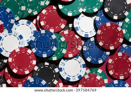 Many poker chips. Many old poker chips. Many color poker chips background, closeup. Background created with casino chips. Fortune, game and entertainment concept - close up of casino chips background. - stock photo