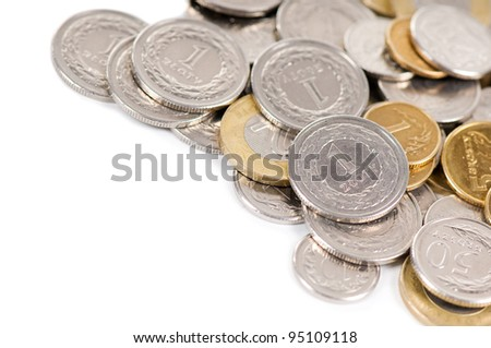Many polish zloty coins lying on white background, one and two value coins, money in horizontal orientation, nobody.