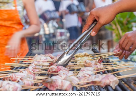 many prawns in bacon bbq sticks on grill, outdoor, summer bbq time - stock photo