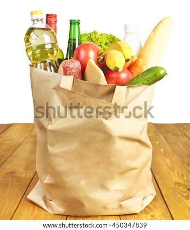 Many products in paper bag - stock photo