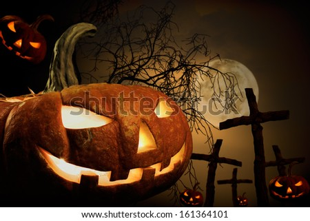 many pumpkin on burying place, concept  religious  feast  Halloween - stock photo