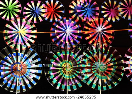 Many rainbow toy windmills prepared for children in Chinese new year - stock photo